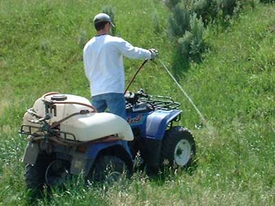 Herbicide being used to control noxious weeds